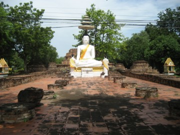 Buddha statue on the remnants of a monastic hall