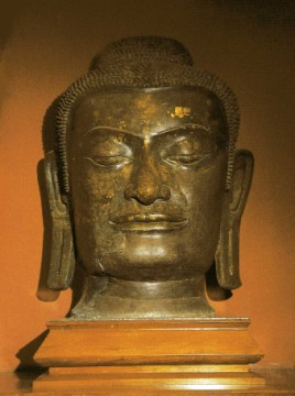 Bronze Buddha head excavated at the temple's location and exhibited at the Chao Sam Phraya museum